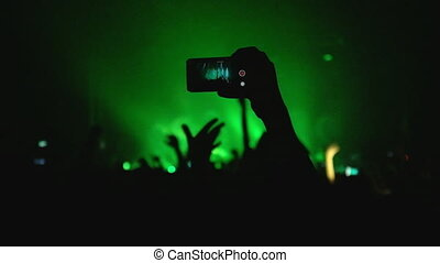 Crowd Filming the Concert