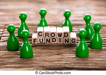 Crowd Funding Word Made With Wooden Blocks