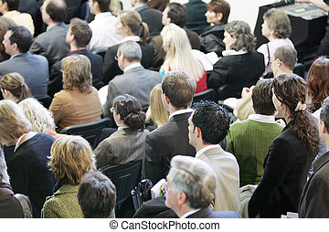 people listening to a speech