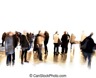 Crowd of blurred people at exhibition or in a museum