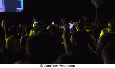 Crowd of Fans with Smartphone Making Live Broadcast in Social Network at Concert