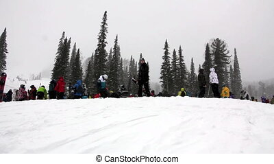 Crowd of people on ski resort in mountains
