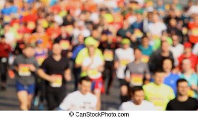 Crowd of people running