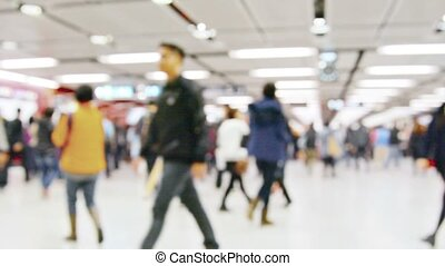 Crowd of People Strolling around a Busy Subway Station -...