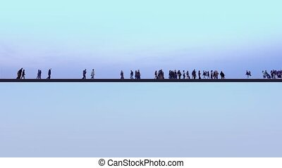 Crowd of people walk along black line on light background