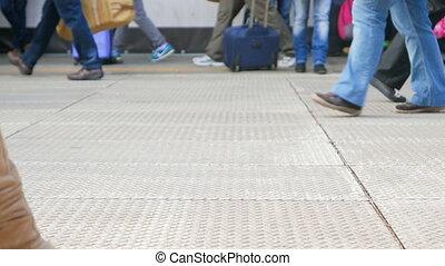 Crowd of People Walking on the Platform