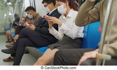 Crowd of people wearing face mask on a crowded public subway train travel