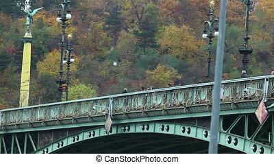 crowd of tourist  walk on Old bridge over vltava, prague