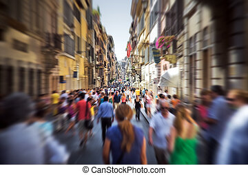 Crowd on a narrow Italian street. Motion blur effect.