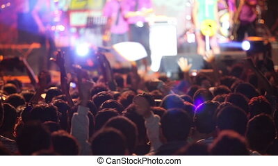 Crowd on concert - Crowd over scene with lights during music...