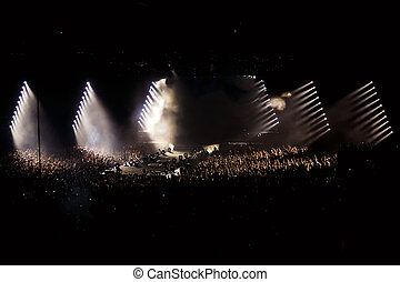 Crowd on concert party, disco light background