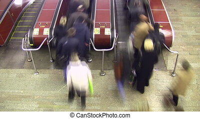 Crowd on escalator. Time lapse. Upper view. Motion blur.
