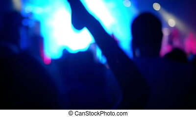 Crowd partying rock concert - Footage of a crowd partying at...