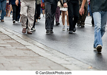 Crowd walking - group of people walking together (motion...