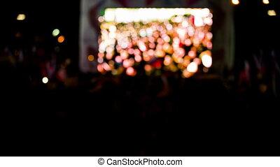 Crowd Waving Flags Watching Concert On Big Screen