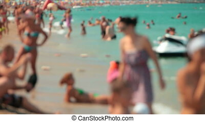Crowded beach full of people in summer