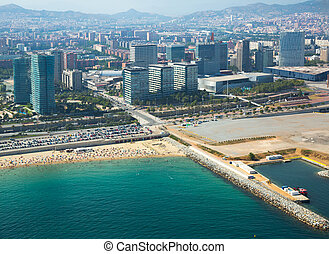 Crowded beach in Barcelona seaside