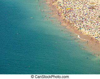 Crowded beach shore