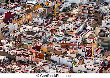 Crowded city roofs top view with many houses