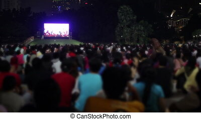 Crowded people watching tv