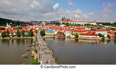 Crowded The Charles Bridge and Vltava river shore - Above...