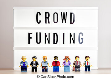 Crowdfunding concept. Illustrative editorial. July 27, 2021