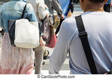 Crowds of pedestrians crossing