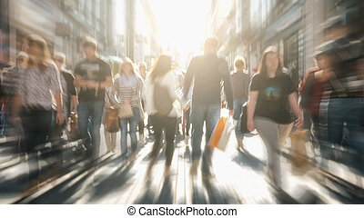 crowds of people in motion blur crossing a city street at...