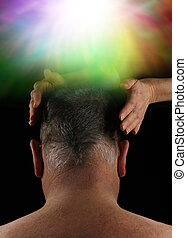 Crown Aura Energy - Back of a man's head with a pair of...