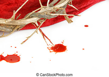 Crown of Thorns on red fabric and drops of blood on white.
