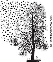 Crows fly away from the tree