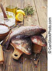 Crucian, fish - Fresh fish crucian on a wooden table