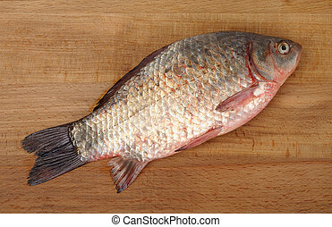 crucian on a wooden background