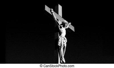 Crucifix 02 - Medium shot of a crucifix rotation