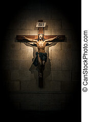 Crucifix in church on the stone wall.