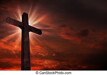 Crucifix in Sunset. Bright Light Above the Crucifix / Cross....