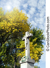 Crucifix in the background of trees