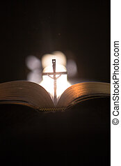 Crucifix in the middle of the bible - Crucifix standing in...
