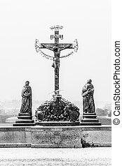 Crucifix statue on Charles Bridge in Prague