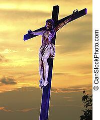 crucifixion against a reddish sky