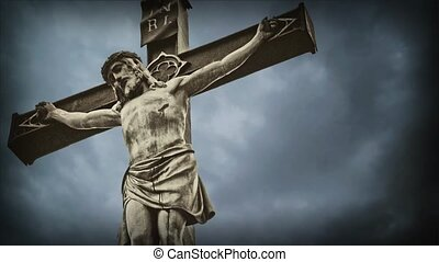 Crucifixion. Christian cross with Jesus Christ statue over stormy clouds time lapse.