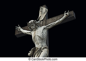 Crucifixion. Christian cross with Jesus Christ statue isolated on black background with clipping work path. Religion and spirituality concept.