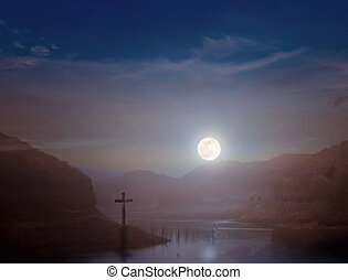 Crucifixion concept: the cross at night with the moon