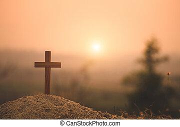 Crucifixion Of Jesus Christ. Christian wooden cross at Sunset. Jesus Christ cross. Easter, resurrection concept.