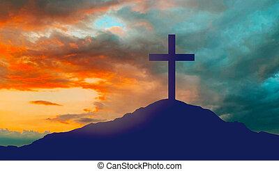 silhouette of cross on calvary hill over sky