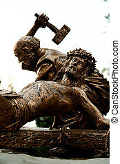 Sculpture depicting the crucifixion of Jesus on the cross.