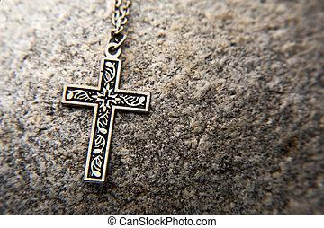 Crucifx on rock