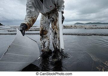 crude oil on oil spill accident on Ao Prao Beach at Samet island