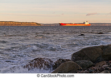 Empty oil tanker near shore.
