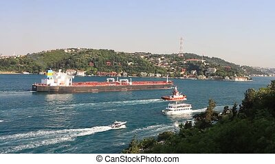 Crude oil tanker ship - Oil tanker with a tug boat sails...